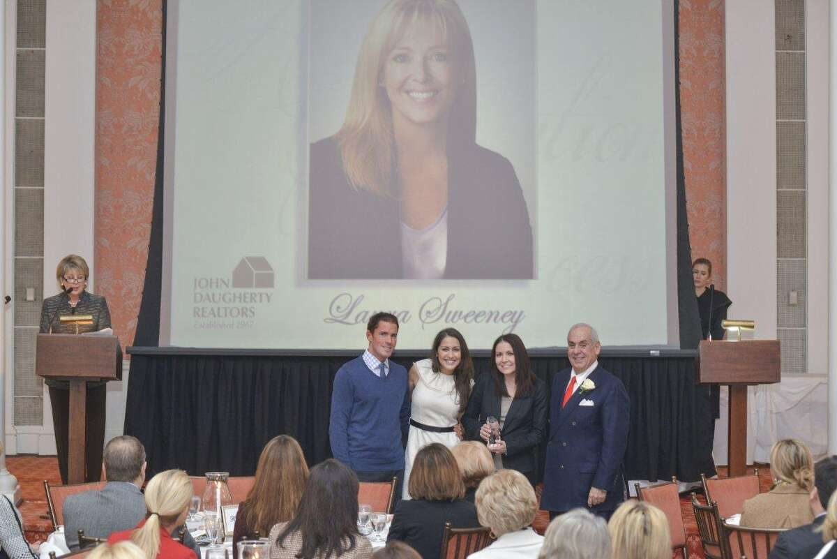 Laura Sweeney was recognized as top producer. From left are Cheri Fama, team members J.B. McGhan, Ashley Miranda and Wendy Rutledge, and John Daugherty.