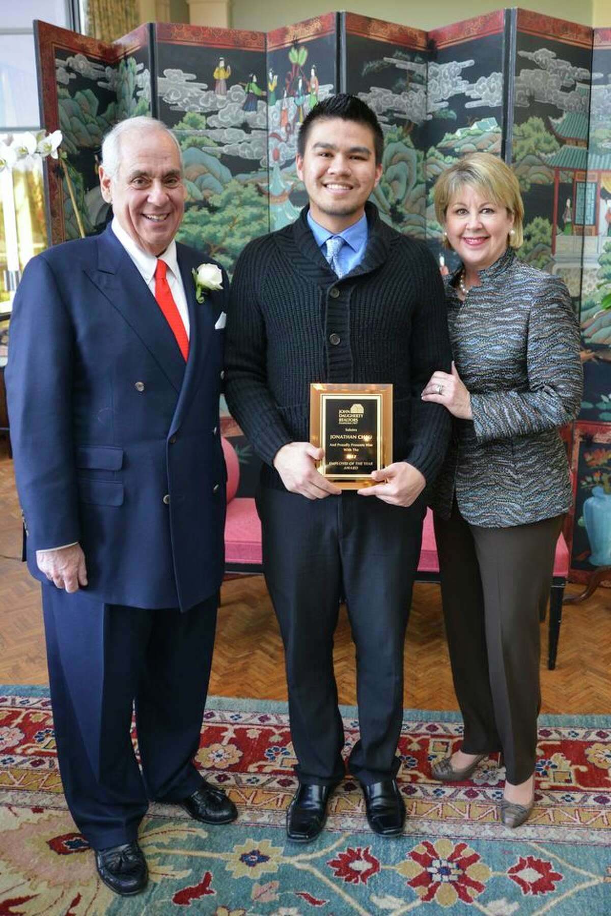 Jonathan Chau, center, was named Employee of the Year. Chau is with John Daugherty and Cheri Fama.