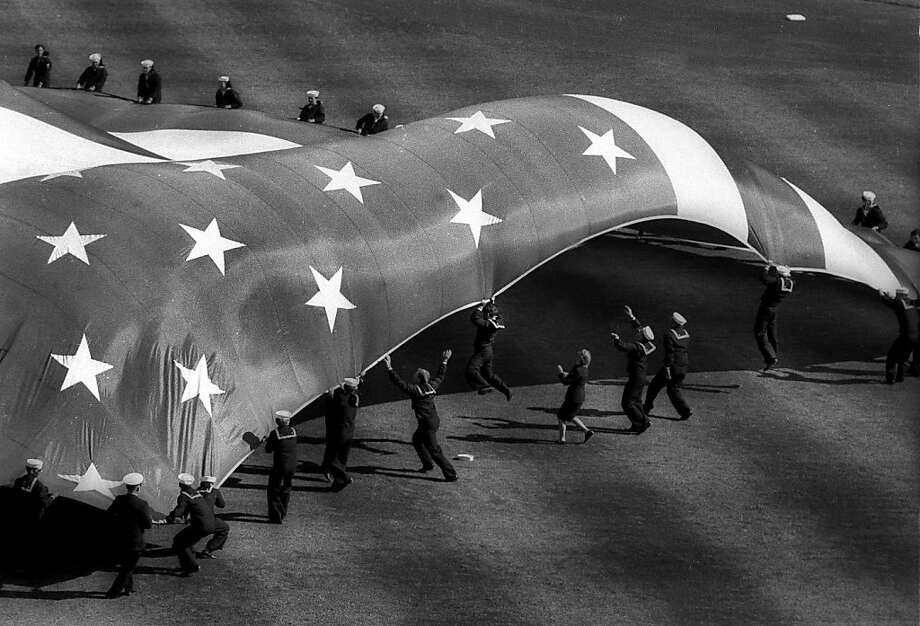 Darn that Candlestick wind! During the 1984 Major League All-Star baseball game at Candlestick Park, a group of local men and women from the US Navy were unable to hold down a huge American flag used during pregame ceremonies when the famous Candlestick winds came up.  Photo: Brant Ward