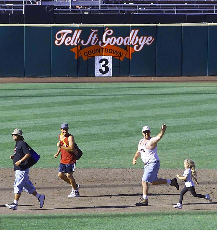 Fans had a final opportunity to run around the bases at Candlestick Park. Their nostalgia won't last long once they see Pacific Bell Park in 2000. Photo: Brant Ward
