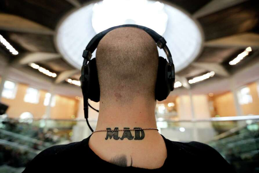A tattoo is seen on a neck of a cameraman following a session of the German parliament at the Reichs