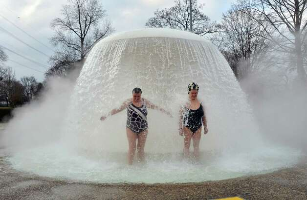 "Two women stand under a fountain in the so-called ""Sonnenbad"" (Sun bath) swimming pool at temperatures just below 0 degrees Celsius during the opening of the pool for the new season Karlsruhe, southern Germany on February 22, 2013. The pool is the first to re-open after being closed for winter.   AFP PHOTO / ULI DECK                      GERMANY OUT Photo: Getty"