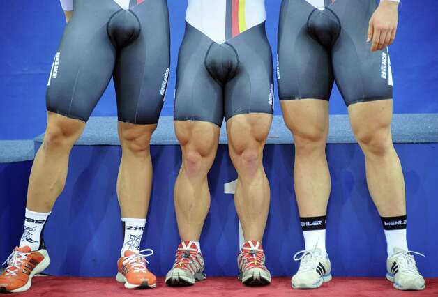The legs of the German cycling team are pictured as they celebrate after winning the gold medal in the Men's Team Sprint event of the UCI Track Cycling World Championships in Minsk on February 21, 2013.  AFP PHOTO / ALEXANDER NEMENOV Photo: ALEXANDER NEMENOV, Getty / 2013 AFP