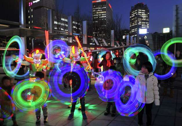 South Korean children play with colorful light sticks for a light show organized by the Everland amusement park in central Seoul on February 21, 2013.  The show came ahead of the first full-moon day on the Lunar Year calendar, which falls on February 24.  South Korean have traditionally observed the day with firework or wielded portable bonfires in cans.  AFP PHOTO / KIM JAE-HWAN Photo: Getty