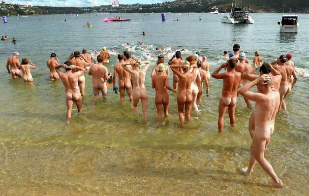 "The first wave of nude swimmers enter the surf in the ""Sydney Skinny"" - in what is dubbed the first mass nude ocean swim in Sydney on February 17, 2013.  The inaugural Sydney Skinny is a gentle 900m nude swim where the emphasis is on enjoying swimming in the nude rather than times and racing.  The event encourages people to try something different and toss out the worries about body image.  AFP PHOTO/William WEST Photo: Getty"