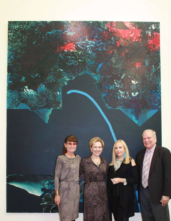 The Dorothy Hood painting Dark Plexus, with supporters who are making Hood's overdue retrospective possible: curator Susie Kalil, Kimberly Stockseth (board member of the Art Museum of South Texas), Carolyn Farb, and Joe Schenk (director of the Art Museum of South Texas).