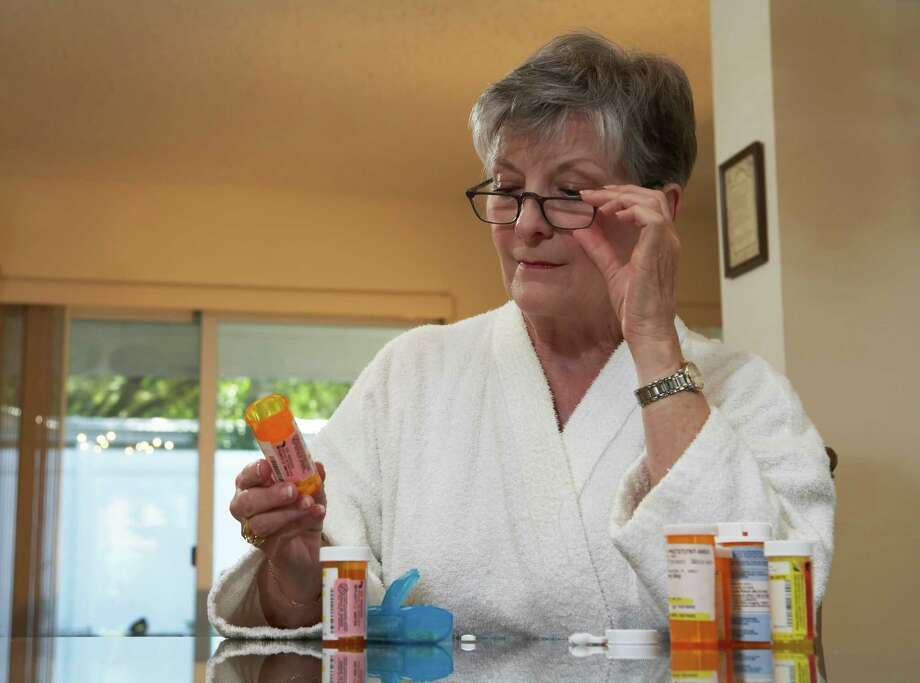 SAFETY IN KNOWLEDGE: Seniors should have periodic reviews of their medications, either during regular physical exams with their physicians or with pharmacists who will conduct a review of a patient's medications. Photo: Stanley Mayhew / iStockphoto