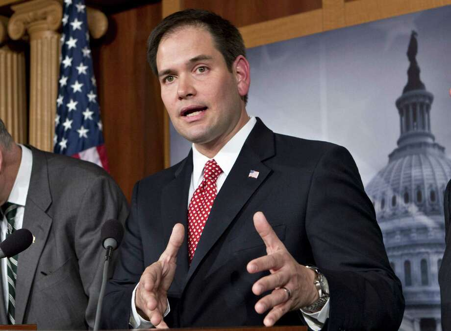 Sen. Marco Rubio's immigration bill essentially offers instant amnesty as does President Barack Obama's. Rubio's plan offers some hope on enforcement. Photo: J. Scott Applewhite / Associated Press