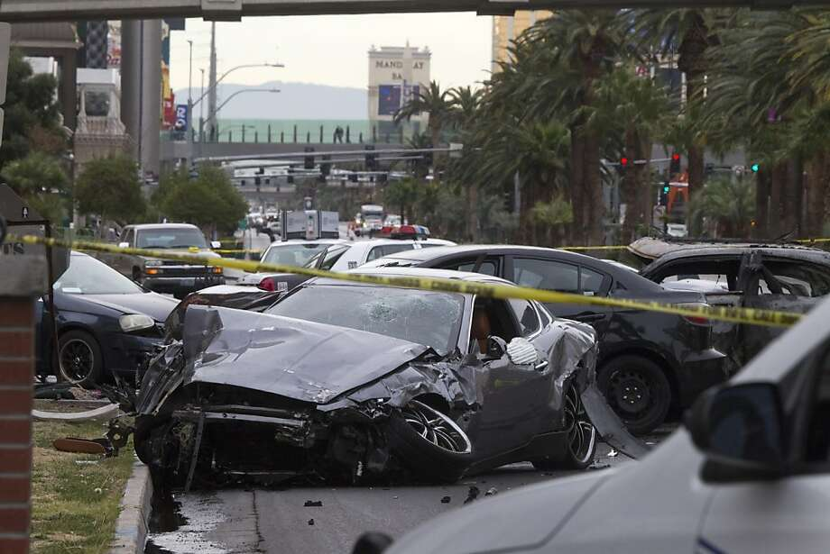 Authorities continue to look for a Range Rover that sped away from a fiery accident on the Las Vegas Strip. Kenny Cherry was driving a Maserati hit by gunfire, and he crashed into a taxi. Photo: Steve Marcus, Associated Press
