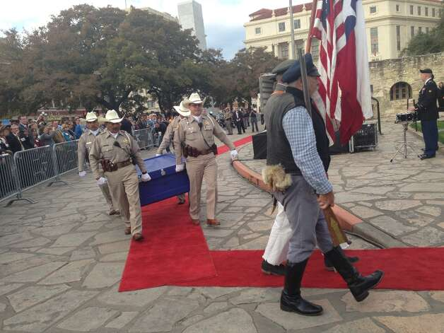 An honor guard carries the Travis Letter to the Alamo Friday afternoon.