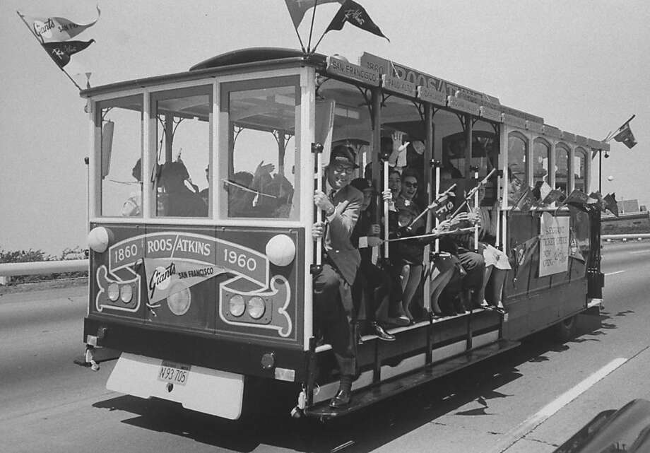 Happy fans being transported to the first game at Candlestick in converted cable car.  Photo: Jon Brenneis, Getty Images