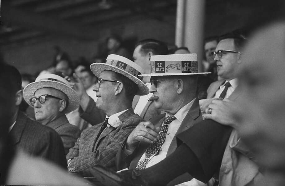 Fans watching the opening game at Candlestick Park wearing wonderful commemorative hats. Photo: Allan Grant, Getty Images