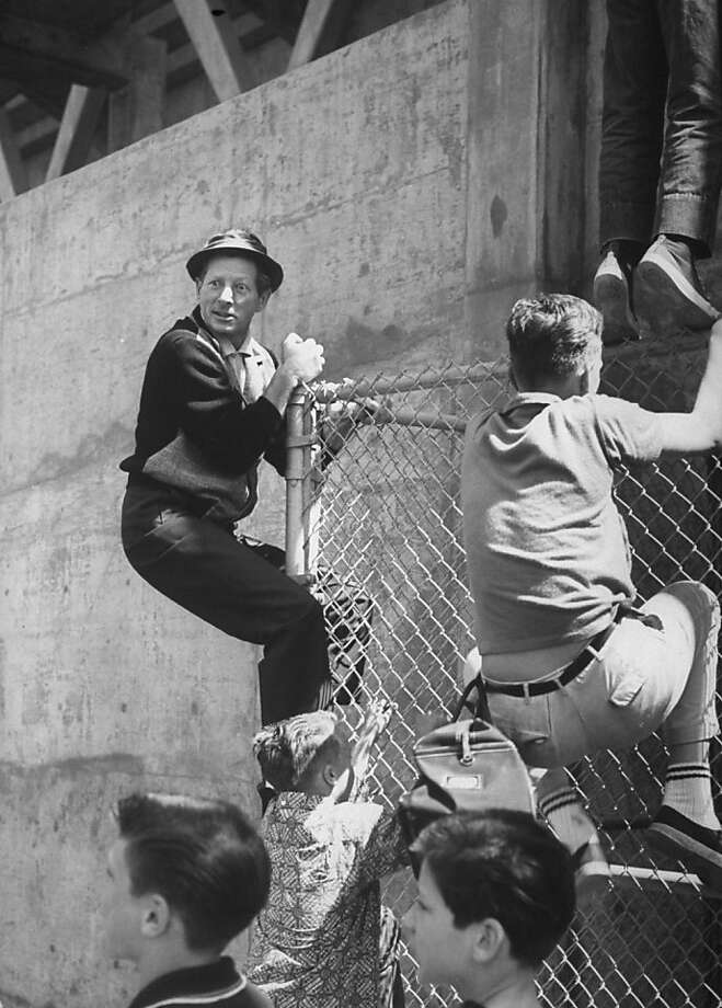 The original caption for this image reads: Danny Kaye climbing a fence with kids. No explanation needed. Photo: Don Cravens, Getty Images