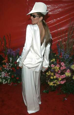 Celine Dion wears a white men's suit backward. Photo: WireImage
