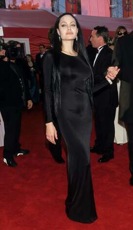 Angelina Jolie imitates Morticia Addams. Photo: WireImage