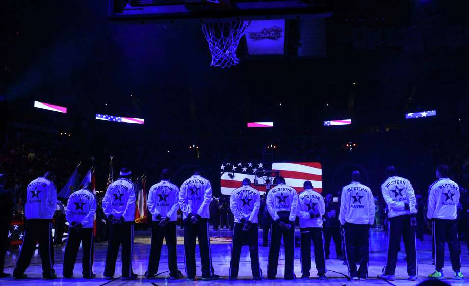 A reader noticed that some players in the NBA All-Star game did not have their hands over their hearts during the national anthem and thinks that military personnel and their families should refuse to watch NBA games until the players show respect for their country. Photo: Bob Donnan, Associated Press