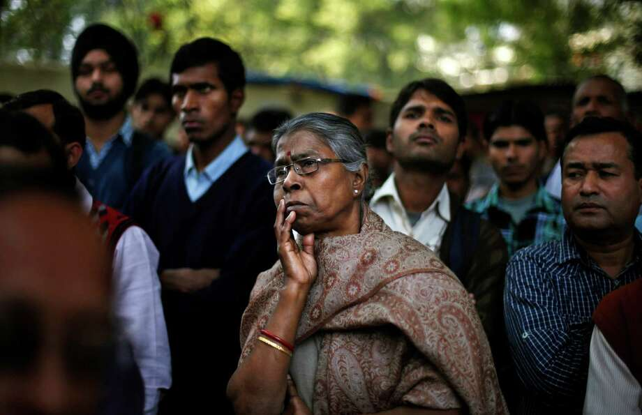 Indian people listen to a speaker, unseen, while they participate in a protest against a new sexual violence law as the parliament convenes in New Delhi, India, Thursday, Feb. 21, 2013. Activists say the law is inadequate and it only partially followed the recommendations of a government panel set up after the fatal gang rape of a woman in New Delhi led to nation-wide protests. (AP Photo/Altaf Qadri) Photo: Altaf Qadri, STR / AP