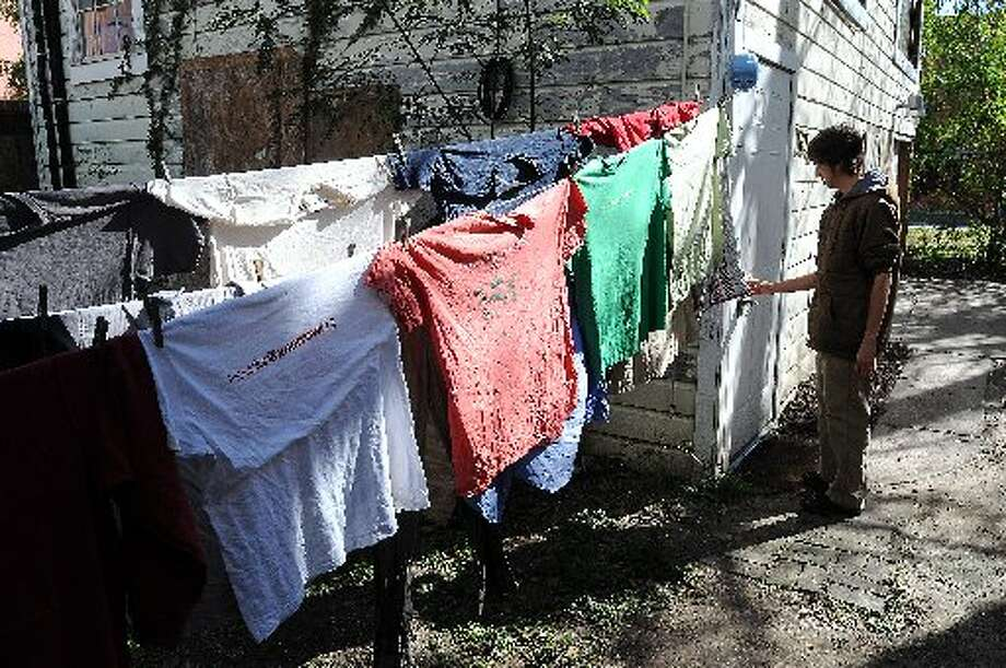 Residents dry their clothes on a clothesline at the Rosalie house.
