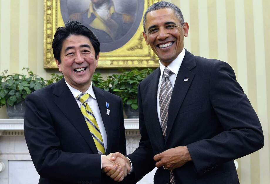 "President Barack Obama and Japan's new conservative Prime Minister Shinzo Abe agreed to seek ""strong actions"" against North Korea's nuclear ""provocations"" during a meeting Friday at the White House. Photo: JEWEL SAMAD, Staff / AFP"