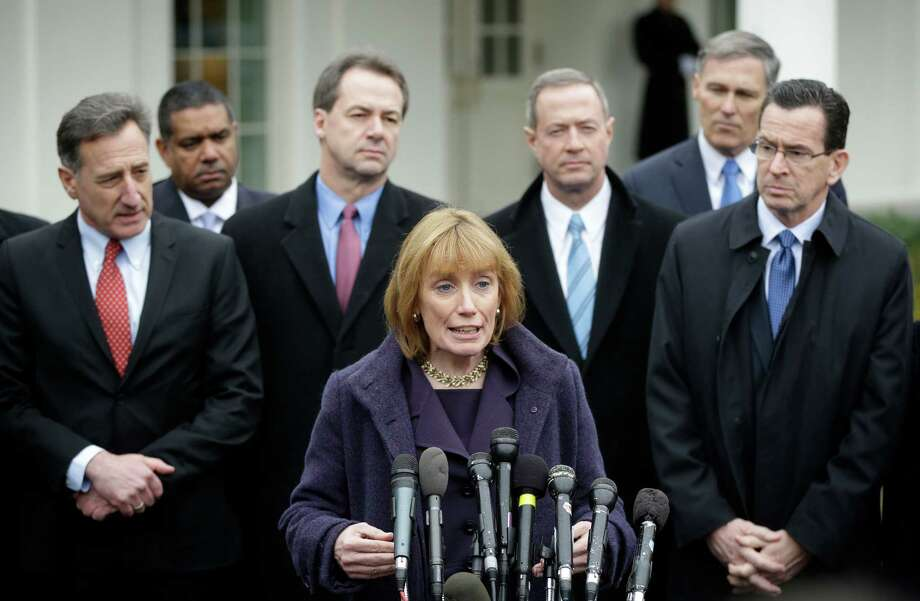 New Hampshire Gov. Maggie Hassan, center, accompanied by fellow members of the Democratic Governors Associations, speaks outside the White House in Washington, Friday, Feb. 22, 2013, following their meeting with President Barack Obama and Vice President Joe Biden. From left are, Vermont Gov. Peter Shumlin, Virgin Islands Gov. John De Jongh, Montana Gov. Steve Bullock, Hassan, Maryland Gov. Martin O'Malley, Washington Gov. Jay Inslee and Connecticut Gov. Dan Malloy. Photo: Pablo Martinez Monsivais, AP Photo/Pablo Martinez Monsivais / Associated Press