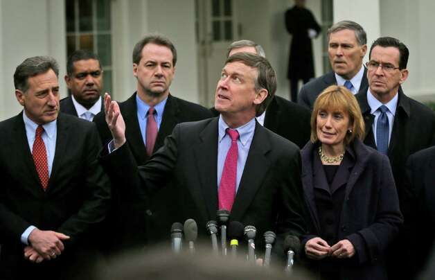 Colorado Gov. John Hickenlooper, center, accompanied by fellow members of the Democratic Governors Associations, looks up to the overcast sky, outside the White House in Washington, Feb. 22, 2013,  following their meeting with President Barack Obama and Vice President Joe Biden. From left are, Vermont Gov. Peter Shumlin, Virgin Island Gov. John de Jongh, Montana Gov. Steve Bullock, Hickenlooper, New Hampshire Gov. Maggie Hassan, Washington Gov. Jay Inslee and Connecticut Gov. Dan Malloy. Photo: Pablo Martinez Monsivais, AP Photo/Pablo Martinez Monsivais / Associated Press