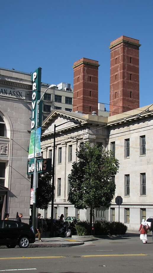 Smokestacks can appear in the most unlikely places in a city -- such as the stocky masonry chimneys atop San Francisco's Old Mint. They've been there since it was built in the early 1870s. Photo: John King, The Chronicle