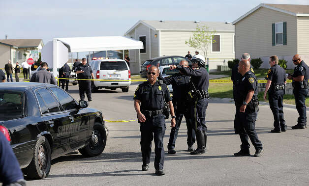 Officers work the crime scene in Summit Ridge was a suspect was encountered after a police shooting in Converse Friday afternoon. Photo: TOM REEL