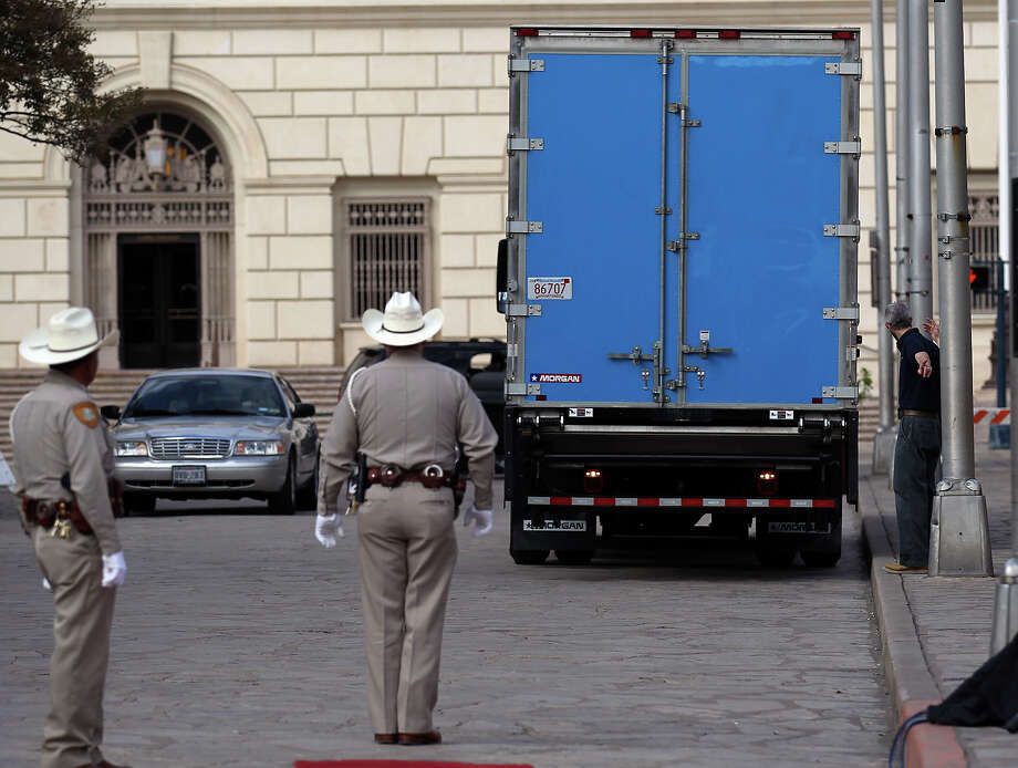 "A truck carrying the crate holding the letter written by Alamo commander Lt. Colonel William Barret Travis arrives at the Alamo before a ceremony to mark its return on Friday, Feb. 22. 2013. The famous ""victory or death"" letter written by Travis that had been kept in Austin until now will be put on display at the Alamo for 13 days starting on Saturday to commemorate the 177th anniversary of the battle at the Alamo. Photo: Kin Man Hui, San Antonio Express-News / © 2012 San Antonio Express-News"