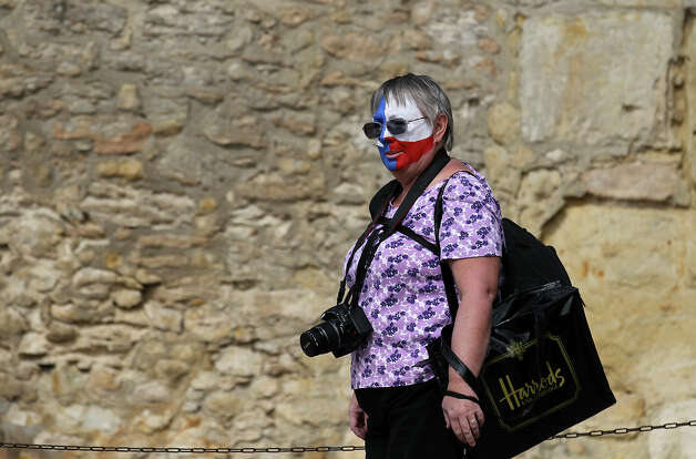 "Lynn Jones from Mequite walks on the ground of the Alamo before a ceremony to mark the return of the letter written by Alamo commander Lt. Colonel William Barret Travis to the Alamo on Friday, Feb. 22. 2013. The famous ""victory or death"" letter written by Travis that had been kept in Austin until now will be put on display at the Alamo for 13 days starting on Saturday to commemorate the 177th anniversary of the battle at the Alamo. ""I've been looking forward to this (moment). It's awesome. I'm probably going to tear up (upon seeing the document),"" said Jones. Photo: Kin Man Hui, San Antonio Express-News / © 2012 San Antonio Express-News"