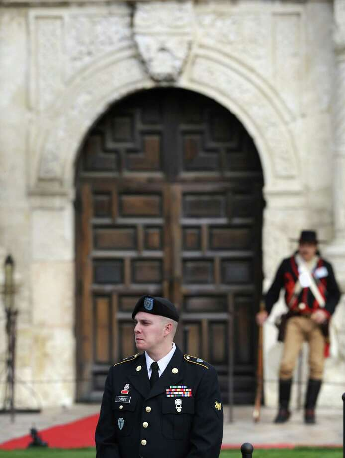 The William Barret Travis Letter, requesting help to defend the Alamo, returned to the Alamo for the first time since it was sent in 1836. Friday, Feb. 22, 2013.  A drummer of the US Army 36th Infantry Division Band waits for the historic document to arrive. Photo: Bob Owen, San Antonio Express-News / © 2012 San Antonio Express-News