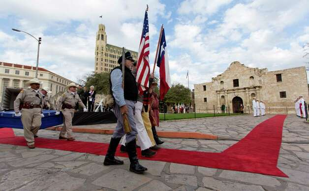"The famous ""Victory or Death"" letter penned on February 24, 1836 by William Barret Travis, Commander of the Texian rebels in the former mission known as the Alamo, is carried Friday Feb. 22, 2013 to the Alamo by Alamo Rangers. The letter is rturning to the Alamo for the first time since it was dispatched by Travis during the battle. It will be on display until March 7. Photo: William Luther, San Antonio Express-News / © 2013 San Antonio Express-News"