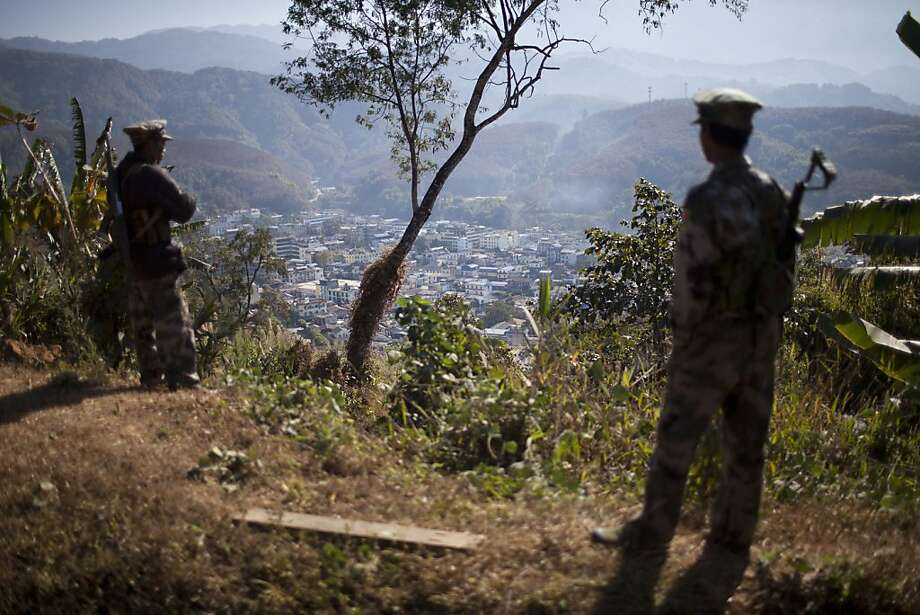 Kachin Independence Army soldiers guard a post on a hill overlooking Laiza, a town partly controlled by the rebels engaged in an ethnic war with Burma. Photo: Alexander F. Yuan, Associated Press