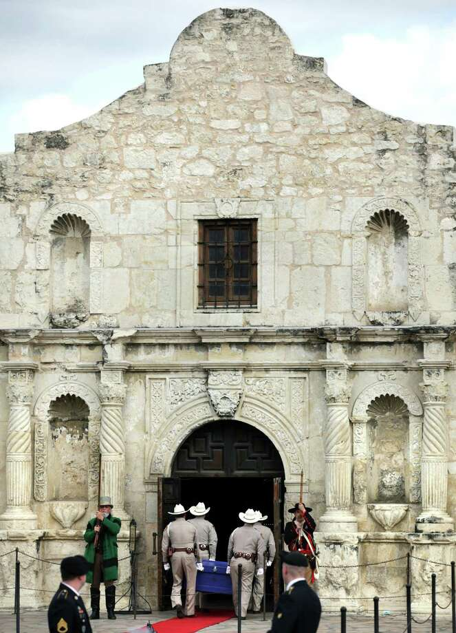 The William Barret Travis Letter, requesting help to defend the Alamo, returned to the Alamo for the first time since it was sent in 1836. Friday, Feb. 22, 2013.  Alamo Rangers carry the historic document through the doors of the Alamo. Photo: Bob Owen, San Antonio Express-News / © 2012 San Antonio Express-News