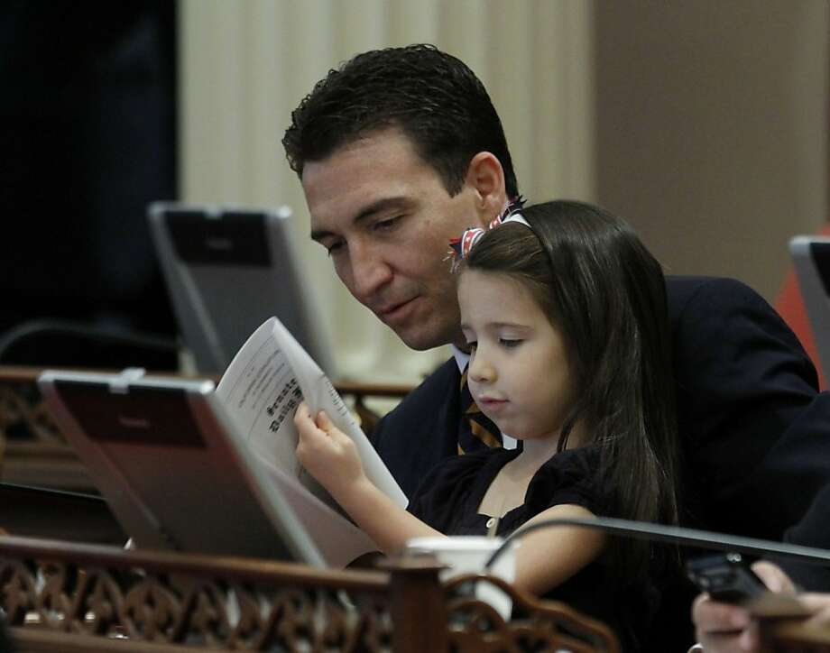 State Sen. Michael Rubio looks over the Senate daily file with his daughter Iliana.  Photo: Rich Pedroncelli, Associated Press