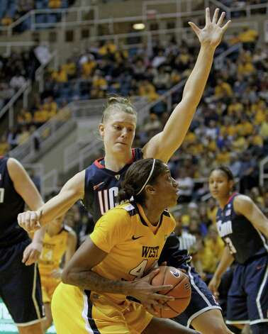 Connecticut's Heather Buck, top, defends West Virginia's Madina Ali in the second half of an NCAA college basketball game in Morgantown, W.Va. on Tuesday, Feb. 8, 2011. Connecticut won 57-51. (AP Photo/David Smith) Photo: DAVID SMITH, ST / FR93543 AP