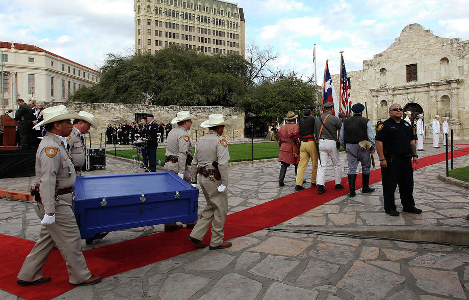 "A crate holding the letter written by Alamo commander Lt. Colonel William Barret Travis is carried toward the Alamo during a ceremony to mark its return on Friday, Feb. 22. 2013 in San Antonio. The famous ""victory or death"" letter written by Travis that had been kept in Austin until now will be put on display at the Alamo for 13 days starting on Saturday to commemorate the 177th anniversary of the battle at the Alamo. (AP Photo/San Antonio Express-News, Kin Man Hui) RUMBO DE SAN ANTONIO OUT; MAGS OUT; NO SALES; MANDATORY CREDIT Photo: Kin Man Hui, Associated Press / San Antonio Express-News"