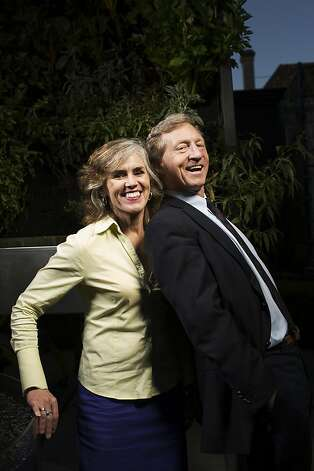 "Tom Steyer and ""Kat"" Taylor get playful in their Pacific Heights backyard with the hydroponic garden as a backdrop. The environment, especially global warming, is his major social issue. Photo: Stephen Lam, Special To The Chronicle"