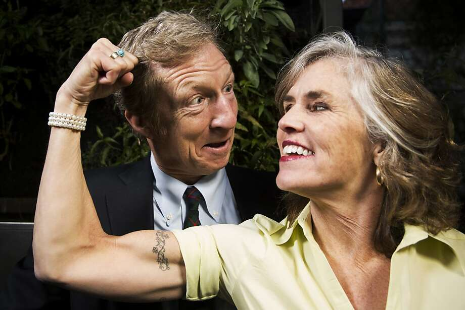 "Tom Steyer and his wife, ""Kat"" Taylor - one of six tattoos showing - use their wealth in pursuit of philanthropic goals. Photo: Stephen Lam, Special To The Chronicle"