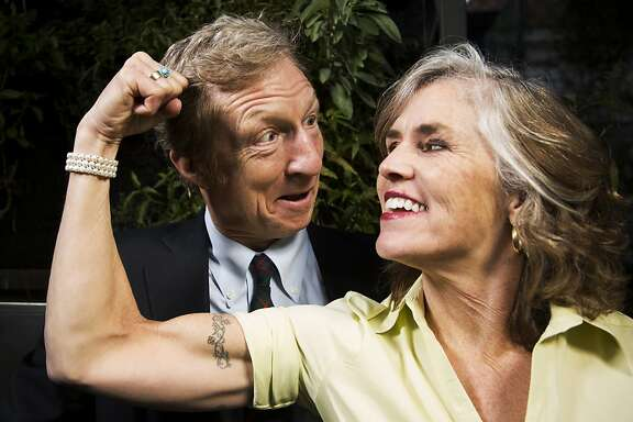 Philanthropists Tom and Kat Steyer stand for a portrait in front of a hydroponics garden in the backyard of their home in San Francisco, Calif. on Thursday, Jan. 31, 2013.