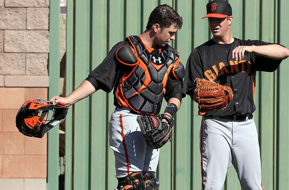 San Francisco Giants pitcher' Matt Cain (18) right discusses his workout with catcher Buster Posey (28) at spring training Friday, Feb. 22, 2013, in Scottsdale, Ariz. Photo: Lance Iversen, The Chronicle