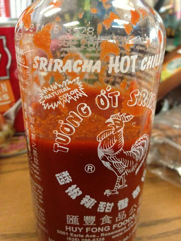 Huy Fong Foods' Sriracha chili sauce is hot despite lack of advertising. Photo: Christopher T. Fong, The Chronicle