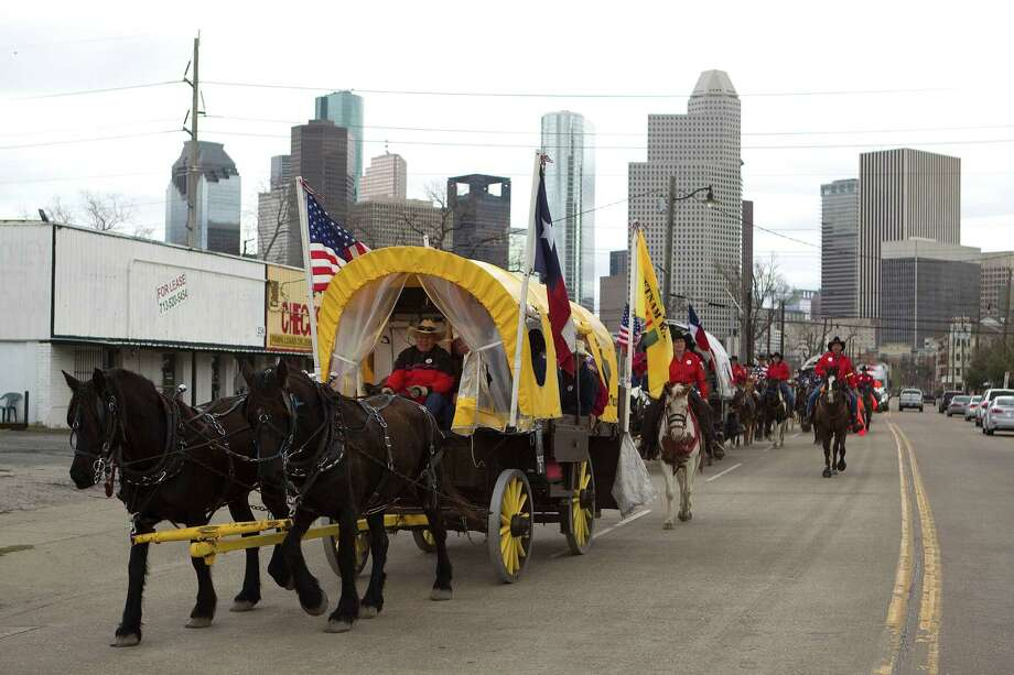 The Texas Independence Trail Ride group makes its way along the 200 block of West Gray Street on their way to Memorial Park to kick off the Houston Livestock Show and Rodeo Friday, Feb. 22, 2013, in Houston. Photo: Johnny Hanson, Houston Chronicle / © 2013  Houston Chronicle