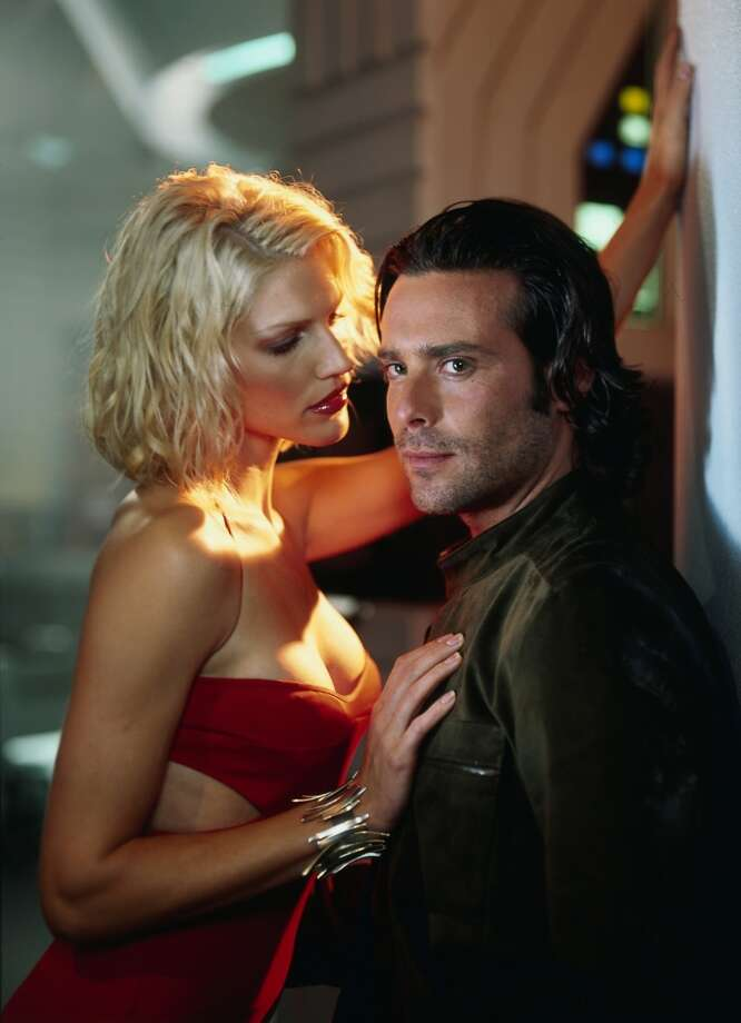 James Callis, right, who played brilliant, arrogant Dr. Gaius Baltar, is pictured with Tricia Helfer as Number Six.