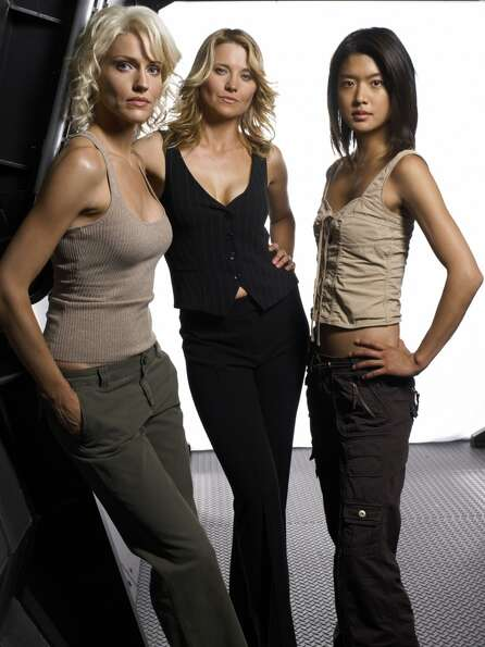 Sexy, tough Cylons from Season 3. From left to right, they are Number Six (Tricia Helfer), Number Th