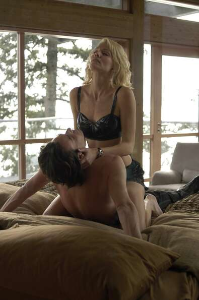 Dr. Baltar (James Callis) and Number Six (Tricia Helfer) from the 2003 ''Battlestar Galactica'' mini