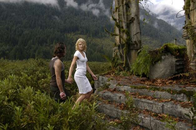 Dr. Baltar (James Callis) and Number Six (Tricia Helfer) appear in this scene from ''Kobol's Last Gleaming: Part 1 & 2,'' which aired in 2005.