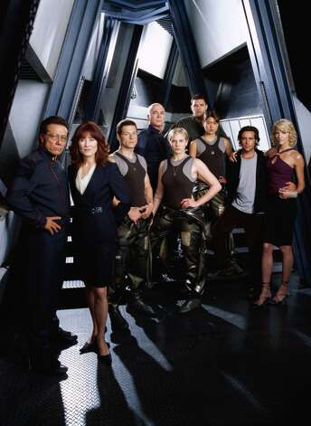 The ''Battlestar Galactica'' crew in 2004 from Season 1: (from left to right)  Edward James Olmos as Cmdr. William Adama, Mary McDonnell as President Laura Roslin, Jamie Bamber Apollo, Michael Hogan as Saul Tigh, Katee Sackhoff as Starbuck, Aaron Douglas as Galen Tyrol, Grace Park as Sharon ''Boomer'' Valerii, James Callis as Gaius Baltar and Tricia Helfer as Number Six