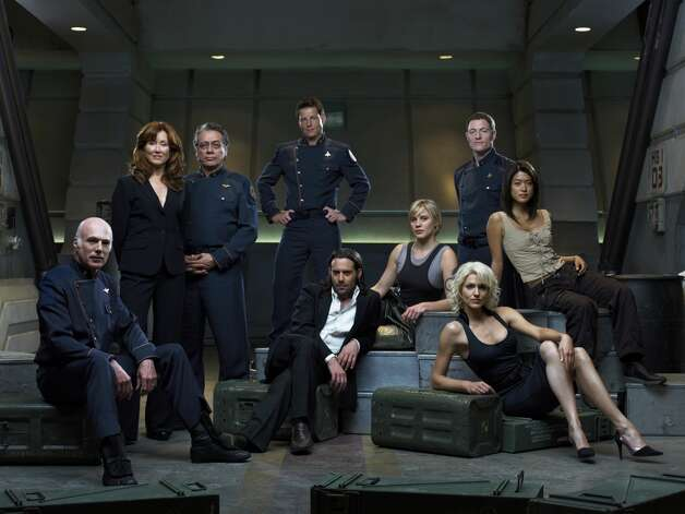 The ''Battlestar'' in Season 3: (l-r) Michael Hogan as Col. Saul Tigh, Mary McDonnell as President Laura Roslin, Edward James Olmos as Adm. William Adama, Jamie Bamber as Captain Lee ''Apollo'' Adama, James Callis as Dr. Gaius Baltar, Kattee Sackhoff as Lt. Kara ''Starbuck'' Thrace, Tahmoh Penikett as Captain Karl ''Helo'' Agathon, Grace Park as Number Eight and Tricia Helfer as Number Six.