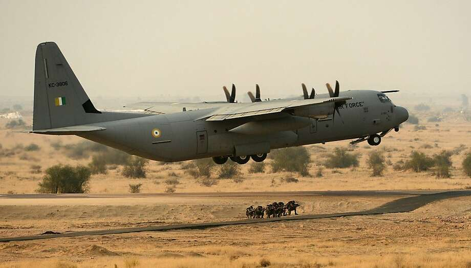 TOPSHOTS Indian Air Force (IAF) C-130J aircraft takes off after performing an assault landing during the Iron Fist 2013 exercise in Pokhran on February 22, 2013. IAF held the Iron Fist 2013 exrecise to showcase its operational capabilities during day,dusk and night taking out simulated targets with precison laser-guided weaponry.    AFP PHOTO/ MANAN VATSYAYANAMANAN VATSYAYANA/AFP/Getty Images Photo: Manan Vatsyayana, AFP/Getty Images