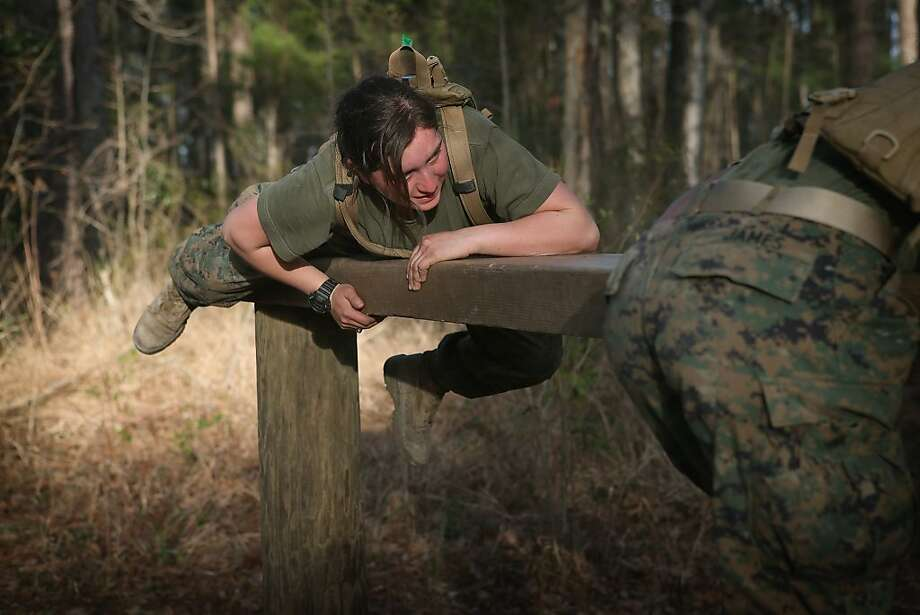CAMP LEJEUNE, NC - FEBRUARY 20: Pfc. Sylvia Ramirez  climbs over an obstacle on the Endurance Course during Marine Combat Training (MCT) on February 20, 2013 at Camp Lejeune, North Carolina.  Since 1988 all non-infantry enlisted male Marines have been required to complete 29 days of basic combat skills training at MCT after graduating from boot camp. MCT has been required for all enlisted female Marines since 1997. About six percent of enlisted Marines are female.  (Photo by Scott Olson/Getty Images) Photo: Scott Olson, Getty Images
